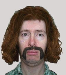 Picture of Dave with horrible hair and daft Jason King moustache