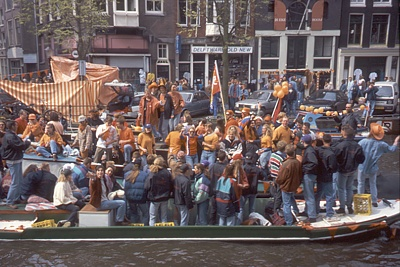 Revellers on an Amsterdam canal on Queen's Day (Koninginnedag)