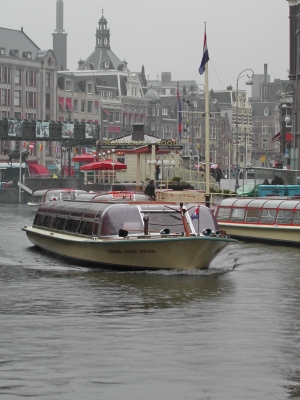 Tourist boat on an Amsterdam canal