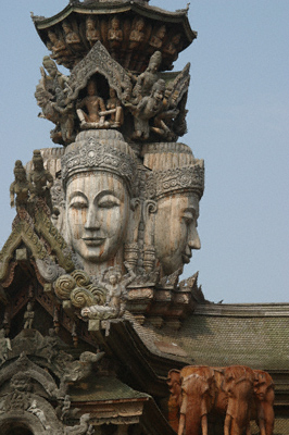 Four-faced wooden sculpture of Brahma on a building