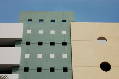 A brightly-coloured concrete car park in Miami