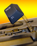 A help key springs from a keyboard
