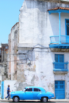 An old blue car in a Cuban street