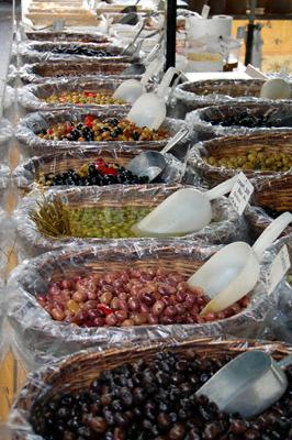 Olives in baskets on sale in a Provencal market