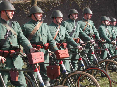 Dutch battle re-enactment club members dressed in 1939 bicycle regiment uniform