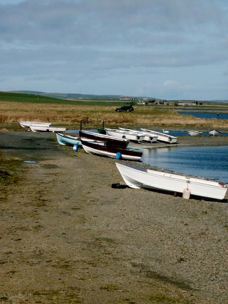 Fishing boats on the shore of the Loch of Harray, Orkney