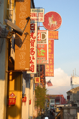 Chinese shopfronts at sunset in Georgetown, Penang