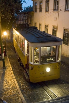 An elderly tram at the top of a hill in Lisbon