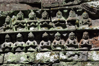 Bas-relief of praying priests on a Cambodian temple wall