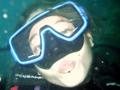 A scuba diver smooches at the camera