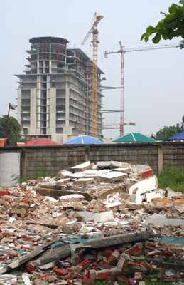 A new hotel block, bungalows and ruins of a demolished house