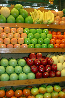 Artificial fruit stacked high on a stall