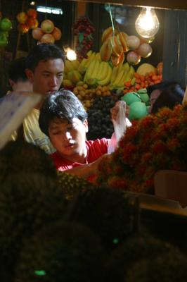 A fruit-stallholder at work in Bangkok's Chatuchak Market