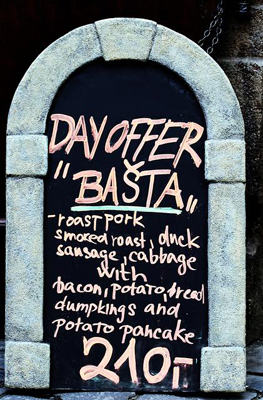 "A ""Daily Special"" blackboard framed by a bright blue archway"