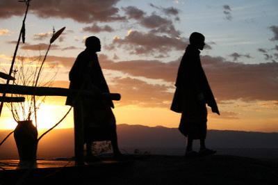 Two Maasai tribespeople at sunset