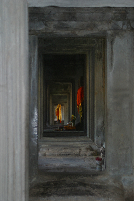 Saffron-robed statues in the galleries at Angkor Wat