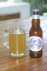 A glass and a bottle of Hoegaarden wheat beer