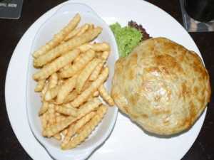Steak and Guinness pie with chips