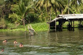 Children playing in the River Kwai in Thailand