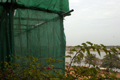 The obscured view northwards from the Bougainvillier Hotel on Sisowath Quay, Phnom Penh