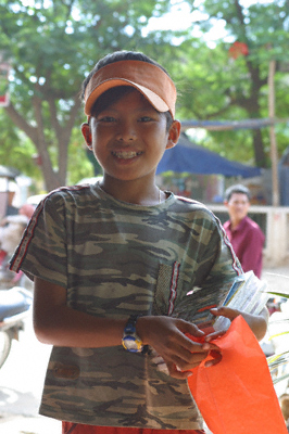 A street kid in Siem Reap smiles for the camera