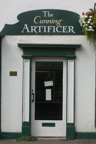 Door of The Cunning Artificer Discworld emporium in Wincanton, Somerset