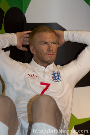 A waxwork of David Beckham in an England kit doing a sit-up on a bench at Madame Tussauds in Bangkok