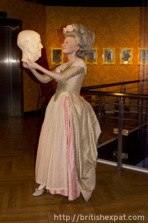 A waxwork of Marie Tussaud herself, with one of her creations