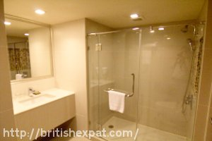 Bathroom and walk-in shower at the President Palace Hotel