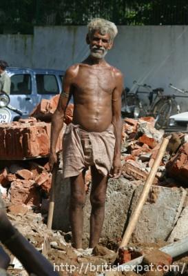A builder on a site in Sarojini Nagar market, New Delhi
