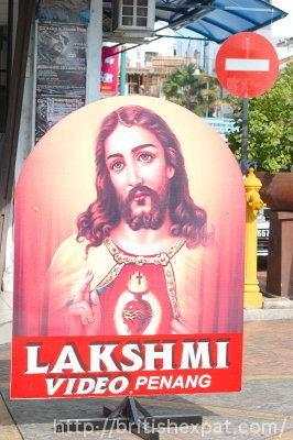 Sign advertising the Lakshmi video shop in Penang, with a rather incongruous Sacred Heart Jesus