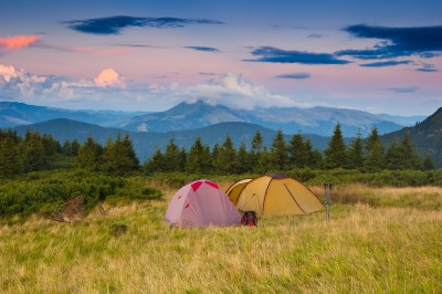 Tents on a hillside in Ukraine's Carpathian Mountains at sunset