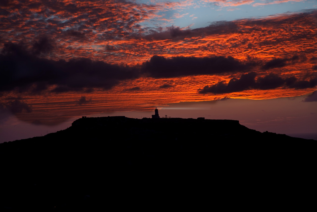 Ġurdan lighthouse in Gozo, seen against the sky after sunset