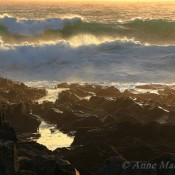 Sunlit waves breaking off the shore at Hamnavoe, Shetland