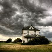 A lonely house under a stormy sky