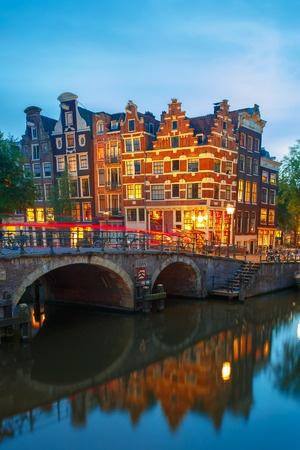 Building at the Lekkeresluis bridge on Amsterdam's Prinsengracht