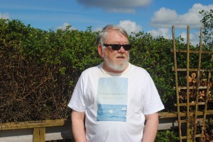 Author Murray Watson with his book's front cover on T-shirt