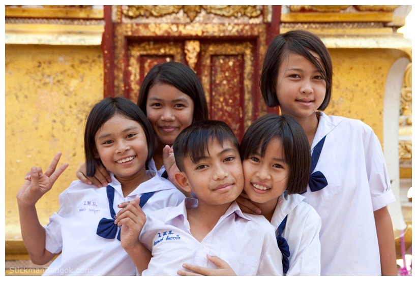 Thai schoolchildren in uniform outside a wat (Buddhist temple)
