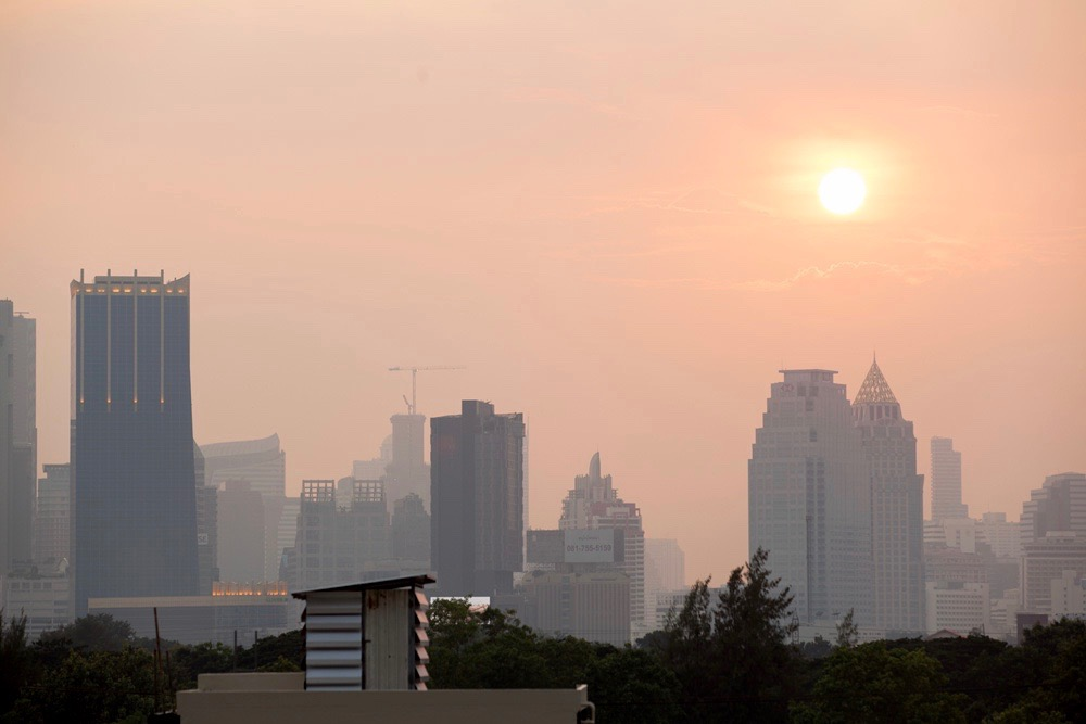 Smoggy Bangkok skyline with the sun struggling to break through