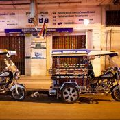 Two tuk-tuks outside a shopfront in Bangkok