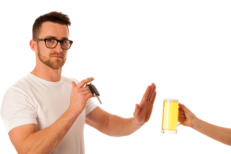 Man holding car keys and refusing a beer