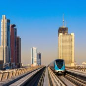 A metro train leaves a station in Dubai