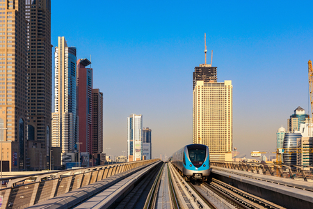A train leaves a metro station in Dubai