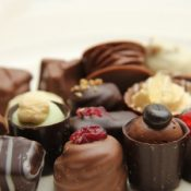 Luxury Belgian chocolate pralines, decorated with fruits and nuts