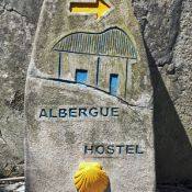 Sign pointing to a pilgrims' hostel in Spain