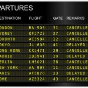 Flight departure board showing delays and cancellations