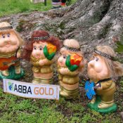 ABBA Gold garden gnomes at the foot of a tree
